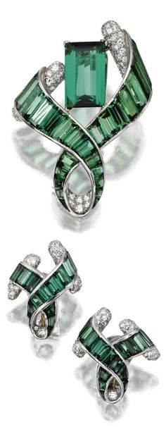 Art Moderne green tourmaline and diamond brooch and ear clips, Verdura, 1948 and 1950. The brooch designed as a curling ribbon tendril framing an emerald-cut tourmaline, completed by baguette and calibré-cut tourmalines, the inside fold of the ribbon and the baton terminals pavé set with small round diamonds, signed Verdura; the matching ear clips similarly decorated with baguette tourmalines and pavé-set diamonds, mounted in platinum. #Verdura #ArtModerne #vintage