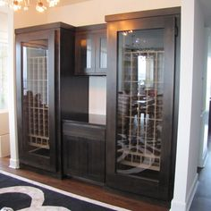 Modern Series Wine Refrigerator with wood wine racks and center wet bar.