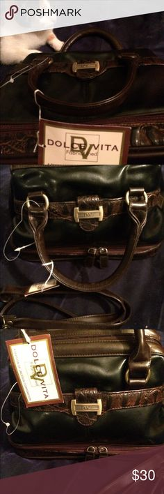 NWT DOLCE VITA PURSE Black and brown with bottom zipped compartments NEW condition very clean inside. Has a shoulder strap included. Beautiful purse. Dolce Vita Bags Shoulder Bags