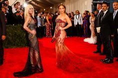 From the Met Gala - Gallery - Style.com. Donatella Versace in Atelier Versace & Jennifer Lopez in Atelier Versace with a Swarovski clutch.