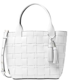 Luxe woven leather details the modern-chic silhouette of this Michael Michael…