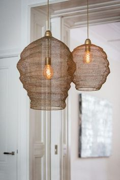 A delicate quirky mesh ceiling light that showcases the exposed bulb inside whilst also creating a beautiful glow of light in the room. These wire mesh lampshades will bring a boho feel to any home. Boho Lighting, Lighting Design, Pendant Lighting, Wall Hanging Lights, Staircase Handrail, Shine The Light, Room Interior Design, Dining Room Lighting, Bronze