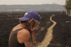 Robert Hooper, exhausted after several days with little sleep, is overcome with emotion while surveying his property that was burnt by the so-called Valley Fire near Middleton, California September 14, 2015.