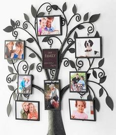 Paint the tree on the wall, then hang the pictures on the branches.... the tree needs to be larger and more full though