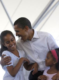 Joking around with his daughters, Malia and Sasha, during a family picnic in Fort Wayne, Indiana in 2008
