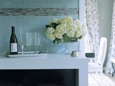 clear blue glass subway tiles and mosaic accent.