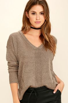 The new episode of your favorite show is on, and you've got a date with the couch, and the Staying In Light Brown Sweater Top! Soft, marl knit shapes a V-neck and a relaxed bodice with side slits. Ribbed knit trims the high-low hem and long sleeves.
