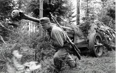 Finnish soldiers towing a 7,5 cm PaK 40 on hard ground.