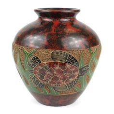 This decorative vase from Nicaragua is 5 inches tall and 5 inches in diameter, featuring a sea turtle design. This is low fired and not designed to hold water.