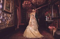 To new beginnings. A bride and groom all dressed up for the Band Baaja Bride Season 5. Her gold lehenga, the Kishandas & Co jewellery, styling... everything is perfect. Get your wedding look styled by our stylist for a picture perfect bridal moment, visit www.bridelan.com #Bridelan #Sabyasachi #sabyasachiweddinglehenga