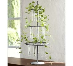 The slender test tube vases of the 3-Tiered Stem Stand from Pottery Barn is perfect for rooting cuttings or displaying small flowers and greenery.