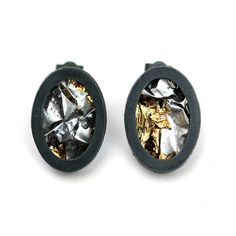 Oxidised Silver & Gold Resin Studs  £95.00  Initially inspired by the reflective surfaces and simple, geometric shapes of modern urban architecture, these minimal oval studs are elegant yet unique.