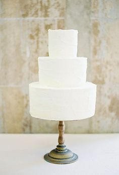 Brides: An Unadorned Three-Tier White Cake. A classic, unadorned three-tier white wedding cake created by Lily Cupcake.