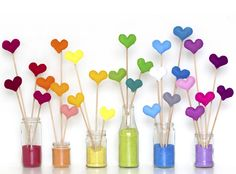 felt hearts on a stick. propped in colored sand.