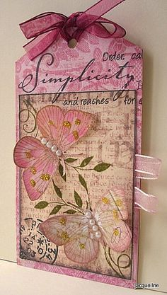 handnmade tag from Jacquelines Craft Nest: Tag Tuesday - Glitter,,,sweet dimensional butterfles with line-of-pearl bodies ... lovely print paper ...
