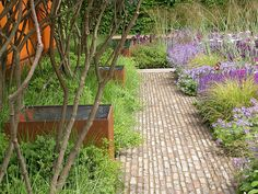 Tom Stuart Smith Strong hardscape structure work well with loose, informal planting.