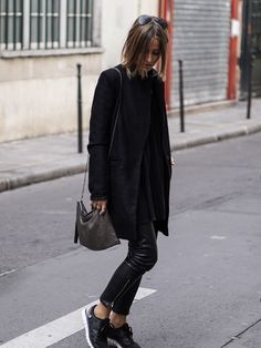 Leather trousers and monochrome sneakers make the... - Street Style