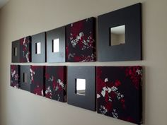 """Picked up some 10"""" x 10"""" canvas, covered them with fabric. Bought the MALMA black mirrors from Ikea at 2.99 /pc. Really cheap and easy to make!"""