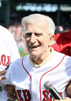 BOSTON, MA - APRIL 13: Former Boston Red Sox Johnny Pesky greets the fans before the home opener between the Boston Red Sox and the Tampa Bay Rays on April 13, 2012 at Fenway Park in Boston, Massachusetts. (Photo by Elsa/Getty Images)