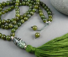 Natural British Columbia (Canada) Nephrite Jade Mala Beads are a lovely shade of olive green. Jade is revered the world over as a gem of universal love, abundance and good luck and is strongly associated with the heart chakra. A beautiful strand of gemstone mala beads for any meditation or affirmation practice.