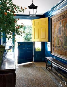 Two toned dutch door in a front foyer entrance hall. Yellow and blue go so well together.  I'm liking the trend of lanterns as entry pendant lights too! http://cococozy.com