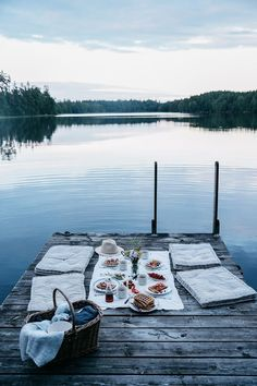 A picnic spread with a beautiful lake as a view