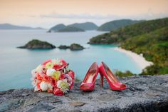 Gorgeous Coral Bouquet from Roses Too and the bride's beautiful coral shoes overlooking Trunk Bay.