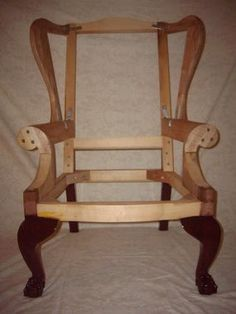 There's no tutorial on this one - but it gives me a look at a chair frame.    Chippendale wing chair frame - Reader's Gallery - Fine Woodworking