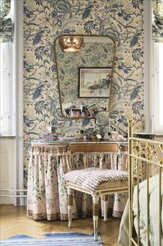 Pretty toile wallpaper in blue and cream with great vanity and mirror.