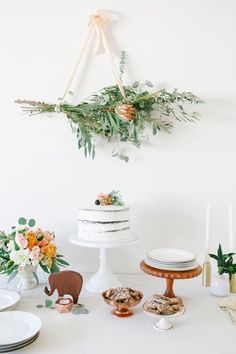 rustic wedding dessert table. Love the hanging protea bouquet!