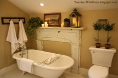 Recycle a fireplace...really not a fan of the claw foot tub, but i do like this idea for a cozy bawwwwthrooooommmm