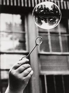 This image of an everyday object is interesting due to the clarity of the bubble and the grain on the rest of the image.