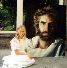 Akiane Kramarik with her painting Prince of Peace age 8