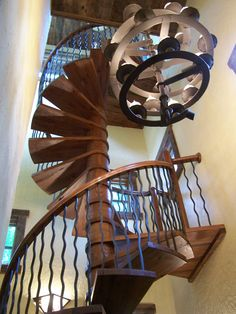This incredible staircase is located inside of The Dobie mountain Lookout. A luxury timber frame home in Northern Georgia.