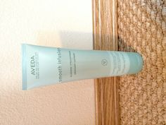 Aveda glossing straightener.  My hair dresser recommended it to me after I complained about my super curly hair always getting kinks in it. This stuff keeps the kinks out. It even made my hair easier to straighten! And it protects from heat damage! It's $22 for this bottle but I use less than a pinkie nails worth for my shoulder length hair. Start at the ends and work your way up. A little goes a long way!