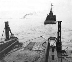 The Mulberry Harbours. Picture showing part of a section of the floating roadway, being towed over the sea to Normandy.