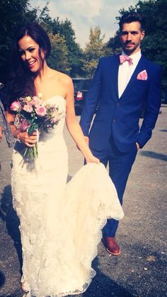 My Stella York dress with bridal wedding flowers, groom in royal blue suite and dusty pink tie .