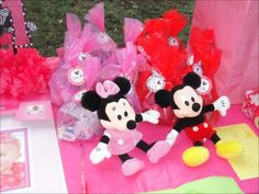 "Party favors for ""Mickey's"" & ""Minnies"". Plus a photo board for everyone to sign!"