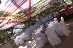 Multi-coloured drapery installed over the dining area #outdoorparty http://www.collection26.com/events/services/private-events/