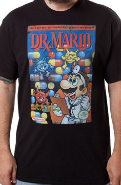 This Dr. Mario shirt features the cover artwork for the 1990 NES and Game Boy video game. In the game, a player advanced through the levels by controlling Megavitamins and landing them on Viruses. Dr.