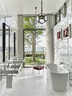 The master bath contains an Albion Bath Co. tub and Catalano sinks | archdigest.com