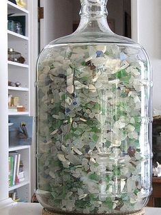 I thought it would take years to fill this large wine-making bottle (carboy) with beach glass, but it appears that I might have to buy another one soon!