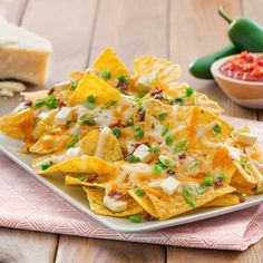 Ultimate Four Cheese Nachos - Create the tastiest Ultimate Four Cheese Nachos, Tostitos® own Ultimate Four Cheese Nachos Recipe with step-by-step instructions. Make the best Ultimate Four Cheese Nachos for any occasion.