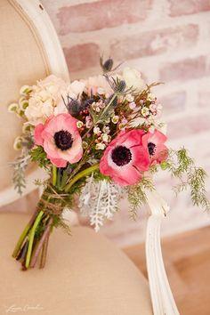Bridesmaid's bouquet {hydrangeas, feverfew, ranunculus, anemones, silver brunia, thistle, wax flower, plumosa, and dusty miller}