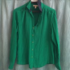 GUC Banana Republic Kelly green silk blouse Gorgeous jewel tones green silk blouse with gold buttons and navy trim. Discoloration on left side near under arm area.  unknown if it could be removed with proper dry cleaning. Banana Republic Tops Button Down Shirts