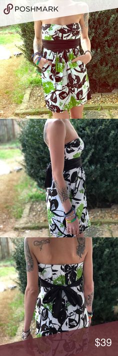 Strapless gorgeous dress with pockets Worn once. Beautiful flower design strapless dress. With real pockets (my personal favorite part).  I believe it is (a very) dark brown and black along with the green. 😍 Dresses Strapless