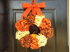 Chocolate, cream and spice hydrangeas with a pumpkin in the center.