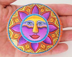 Colorful Sun Hand painted  On A Round Sea Stone ! Is painted  with high quality Acrylic paints and finished with glossy varnish protection