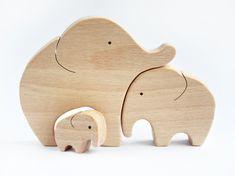 Elephants Family Wooden Puzzle Elephant Toy Hand Cut Wooden Toy Elephant Decor Wooden Puzzle Elephant figurine  Wooden animals by WoodAndYarnToys on Etsy https://www.etsy.com/ch-en/listing/233503324/elephants-family-wooden-puzzle-elephant