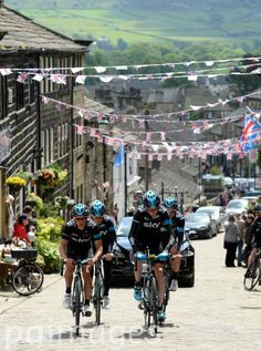 Chris Froome (front right ) rides alongside Richie Porte as the Sky riders climb the cobbled hill at Haworth as they look at the route for Stage 2 of the Tour de France between York and Sheffield as Froome prepares to defend his title in the famous Race following a photocall in Harrogate, Yorkshire.